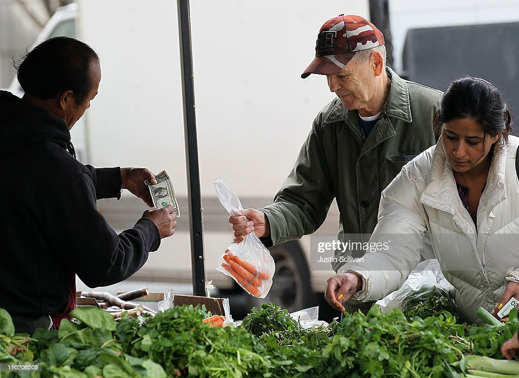 Customers pick through fresh vegetables at a farmers market on March 16, 2011 in San Francisco, California. Wholesale prices in the United States spiked last month with a 3.3% rise in energy prices and a 3.9% jump in food prices.
