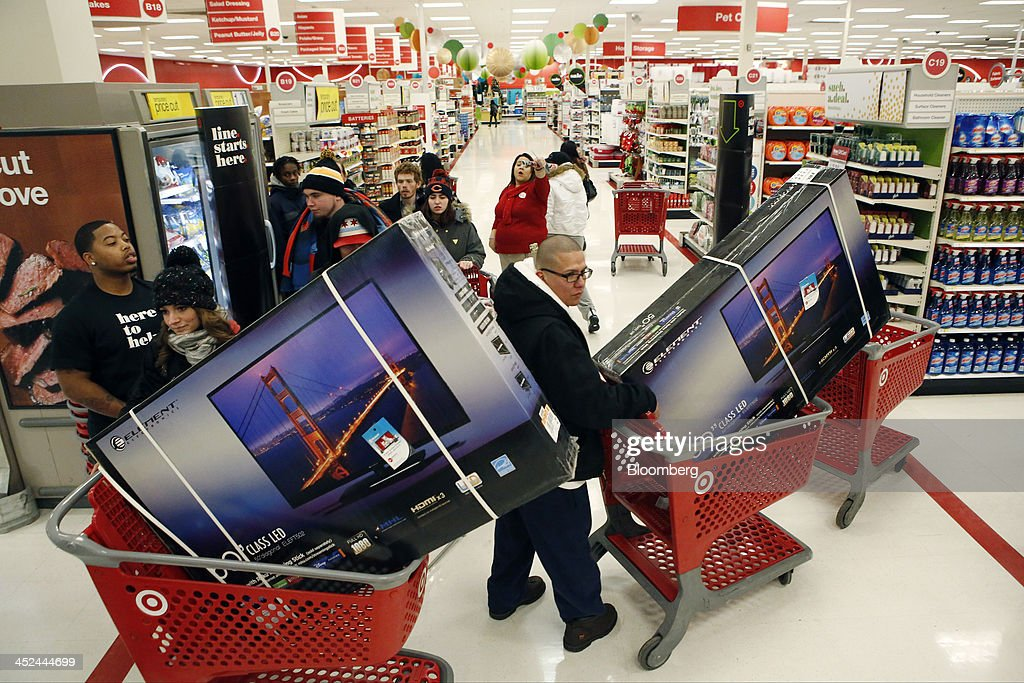 Customers pick up shopping carts containing Element Electronics 50-inch light-emitting diode (LED) high definition televisions at a Target Corp. store opening ahead of Black Friday in Chicago, Illinois, U.S., on Thursday, Nov. 28, 2013. U.S. retailers will kick off holiday shopping earlier than ever this year as stores prepare to sell some discounted items at a loss in a battle for consumers. Photographer: Patrick T. Fallon/Bloomberg via Getty Images