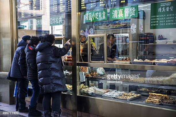 Customers place their orders at a halal food store in Beijing China on Wednesday Dec 2 2015 China's great rebalancing the longsought shift away from...