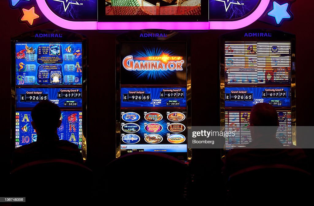 Customers play slot machines at Aspers Casino at Westfield Stratford City Mall in London, U.K. on Wednesday, Jan. 11, 2012. Westfield Group agreed to sell its 75 percent interest in the Broadmarsh shopping center to Capital Shopping Centres for 55 million pounds. Photographer: Simon Dawson/Bloomberg via Getty Images