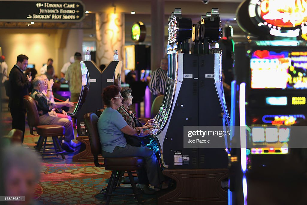 Customers play slot machines in the casino that will hold its grand opening on Friday located in the Hialeah Park Race Track which first opened in 1925 on August 28, 2013 in Hialeah, Florida. The new casino is located in the same complex as the race track which in its heyday was known as the 'the worlds most beautiful race course.'