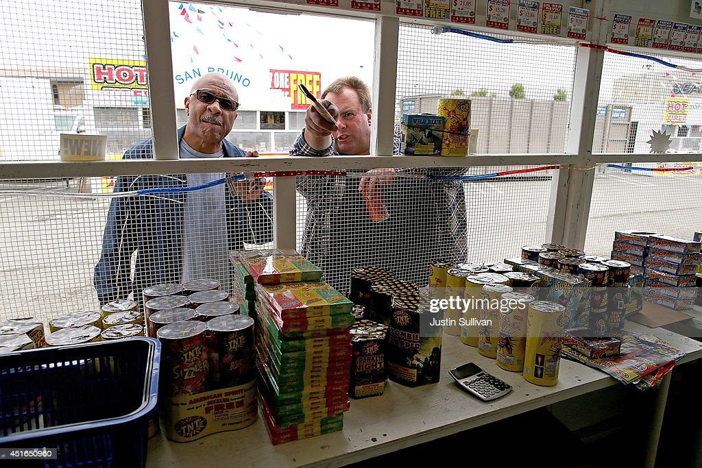 Customers prepare to purchase fireworks at the Camp St. Andrews fireworks stand on July 3, 2014 in San Bruno, California. As California's historic drought continues and fire danger is at severe levels, fire departments in the greater San Francisco Bay Area are on heightened alert as vendors in select cities in Santa Clara, San Mateo and Alameda counties sell fireworks ahead of the Fourth of July holiday.