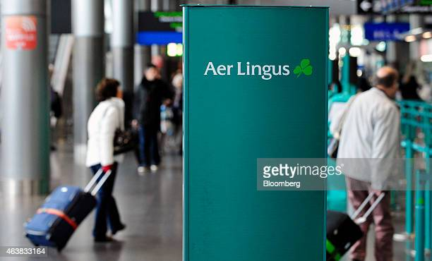 Customers pull their luggage as they arrive at the Aer Lingus Group Plc checkin desks in the departure hall at Dublin Airport operated by Dublin...