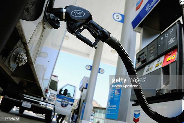 Customers pump gas at an Arco station on July 2 2012 in Los Angeles California According to a gasoline industry tracker recent dropping gas prices...