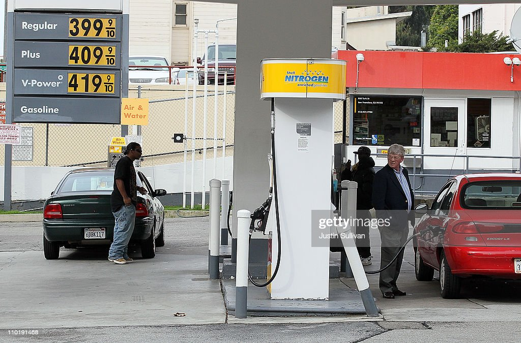 Customers pump gas into their cars at a Shell gas station on March 16, 2011 in San Francisco, California. Wholesale prices in the United States spiked last month with a 3.3% rise in energy prices and a 3.9% jump in food prices.