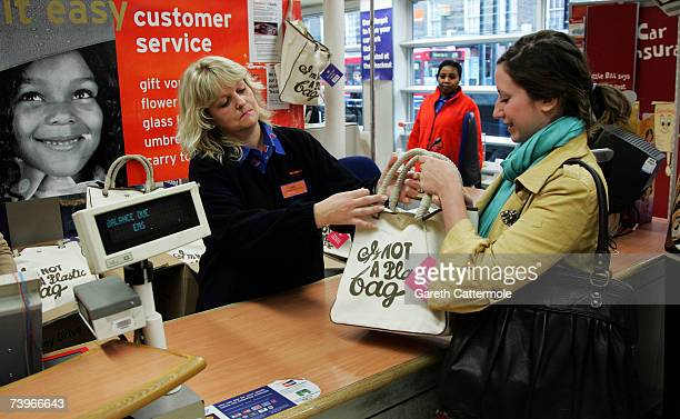 Customers purchase Anya Hindmarch's 'I'm Not A Plastic Bag' from the Sainsbury's store in Camden on April 25 2007 in London The limited edition bags...