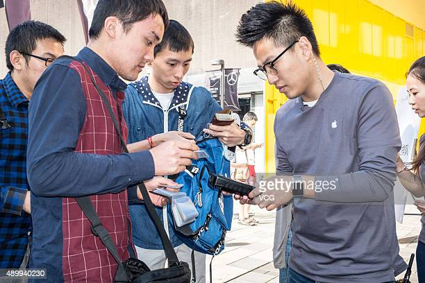 Customers purchase at Sanlitun Apple store on September 25 2015 in Beijing China Apple launched the new iPhone 6s and iPhone 6s Plus on September 25...