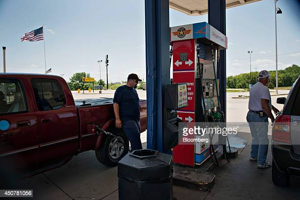 Customers purchase fuel at a Road Ranger gas station in Princeton Illinois US on Tuesday June 17 2014 Gasoline in the US climbed this week boosted by...