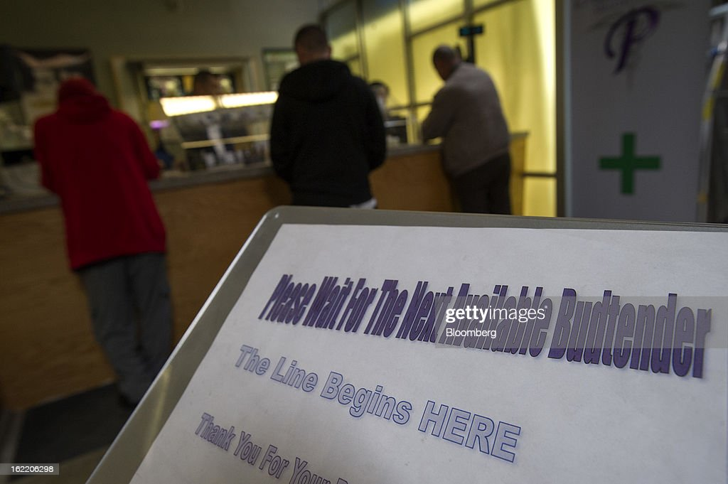 Customers purchase items at Palliative Health Center medical-marijuana shop in San Jose, California, U.S., on Thursday, Feb. 7, 2013. The dispensary, which provides monthly classes on cooking with marijuana-infused products, draws tech workers from employers including Adobe Systems Inc., EBay Inc., Cisco Systems Inc., Hewlett-Packard Co. and Applied Materials Inc., according to Ernie Arreola, the assistant manager. Photographer: David Paul Morris/Bloomberg via Getty Images