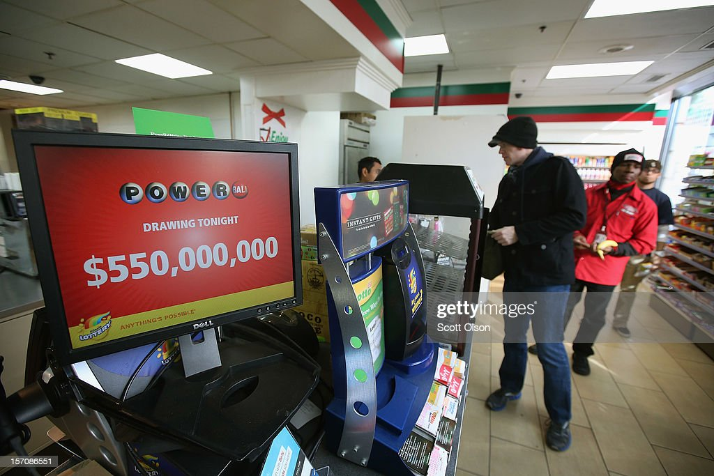 Customers purchase Powerball lottery tickets at a 7-Eleven store on November 28, 2012 in Chicago, Illinois. Jim Bayci, who owns the store, estimates more than half of his customers included at least one Powerball ticket with their purchase today. The jackpot for Wednesday's Powerball drawing is currently at $550 million which is the richest Powerball pot ever. It is likely to rise even more as people continue to buy before tonights drawing.