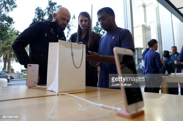Customers purchase the new Apple iPhone 8 at an Apple Store on September 22 2017 in San Francisco California The new Apple iPhone 8 and 8 Plus as...