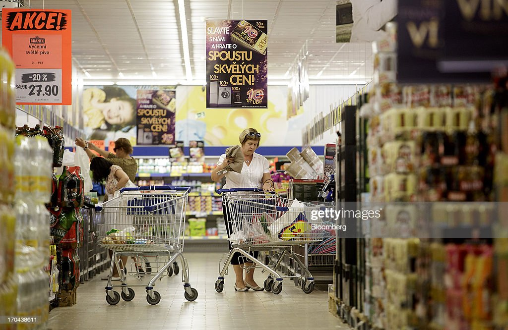 Customers push shopping carts along an aisle while shopping inside a Lidl discount supermarket store, operated by Schwarz Group, in Prague, Czech Republic, on Thursday, June 13, 2013. Ahold and Tesco are tied as the Czech Republic's third-largest grocer by revenue behind Lidl discount store owner Schwarz Group and Rewe AV, which owns the Billa supermarkets, according to Krakow, Poland-based market researcher PMR. Photographer: Martin Divisek/Bloomberg via Getty Images