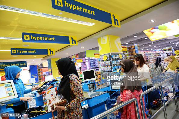 Customers queue at a checkout counter at a Hypermart supermarket operated by PT Matahari Putra Prima in Karawaci Banten Indonesia on Friday Jan 23...