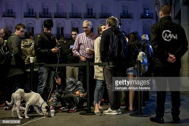 Customers queue at dawn at Puerta del Sol Apple Store before its opening the day the company launches their Iphone 7 and 7 Plus on September 16 2016...