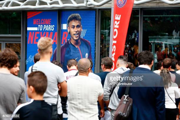 Customers queue at the entrance to the ParisSaintGermain football club store on the Champs Elysees avenue in Paris on August 4 after Brazilian...
