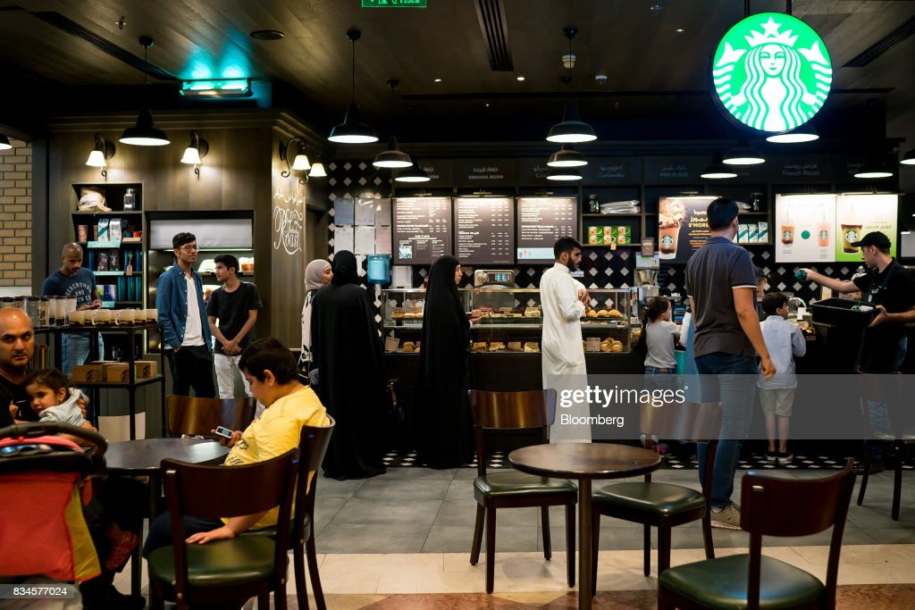 Customers queue at the food counter of a Starbucks Corp. coffee shop at the Souq Sharq shopping mall in Kuwait City, Kuwait, on Monday, Aug. 14, 2017. Kuwait will issue a tender to build the estimated $1.2 billion Dibdibah solar-power plant in the first quarter of 2018 as part of the countrys plans to produce 15 percent of power from renewable energy by 2030. Photographer: Tasneem Alsultan/Bloomberg via Getty Images