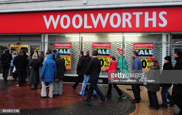 Customers queue at Woolworths in Whitley Bay near Newcastle to take advantage of hefty price cuts as the company struggles to find a buyer for its...