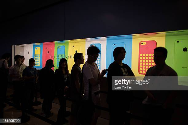 Customers queue before being let into Apple's store in Central district on September 20 2013 in Hong Kong China Hong Kong was one of the first places...