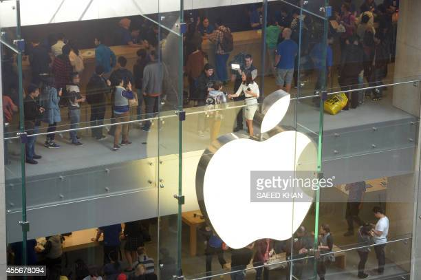 Customers queue in an Apple store to buy the iPhone 6 in Sydney on September 19 2014 Hundreds of people queued through the night in Sydney to be...