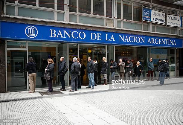 Customers queue outside a Banco de la Nacion Argentina branch on September 01 2015 in Buenos Aires Argentina US Dollar has raised it's quotation 95%...