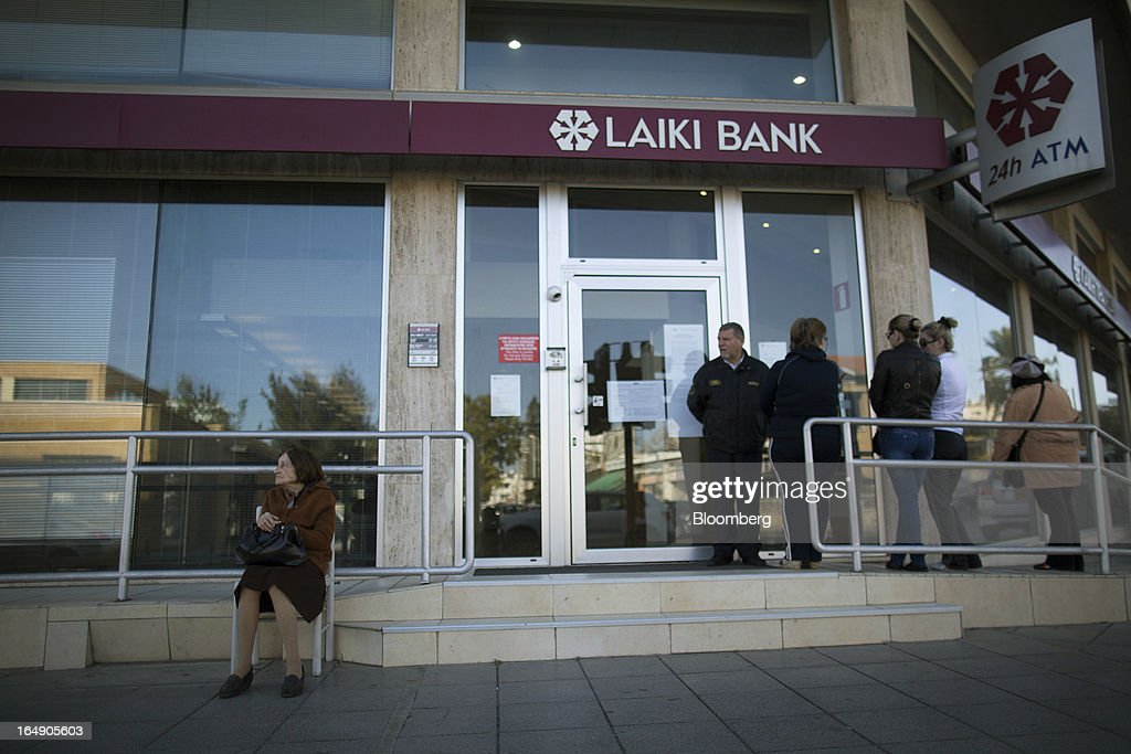 Customers queue outside a branch of a Cyprus Popular Bank Pcl, also known as Laiki Bank, in Nicosia, Cyprus, on Friday, March 29, 2013. Cypriots face a second day of bank controls over their use of the euro as officials in Europe urged the country to move quickly to lift the restrictions, the first time they have been imposed on the common currency. Photographer: Simon Dawson/Bloomberg via Getty Images