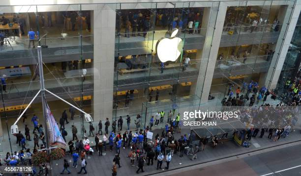 Customers queue outside an Apple store to buy the iPhone 6 in Sydney on September 19 2014 Hundreds of people queued through the night in Sydney to be...
