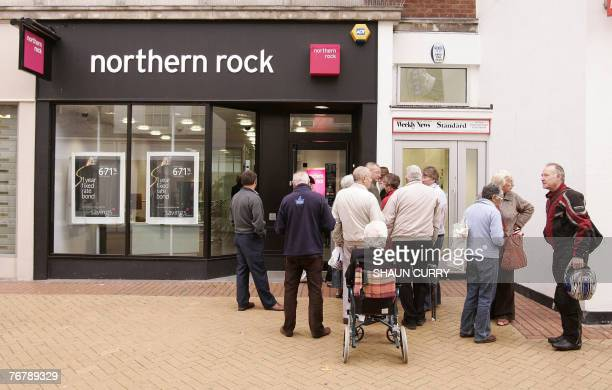 Customers queue to enter a Northern Rock branch in Chelmsford in Essex in southeast England 17 September 2007 British finance minister Alistair...