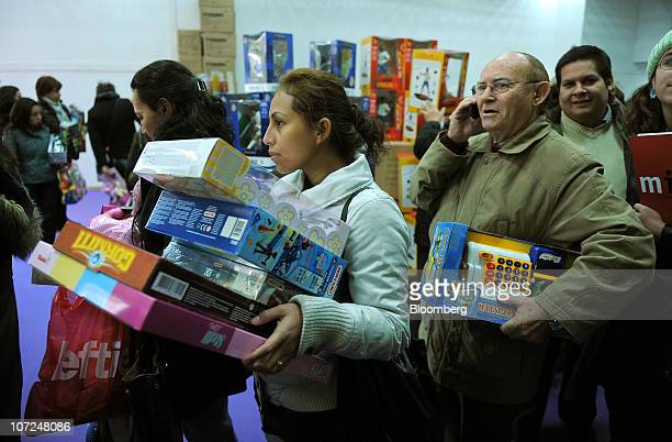 Customers queue to pay for discounted Christmas toys priced at 10 euros in a store in Madrid Spain on Thursday Dec 2 2010 Registered unemployment in...