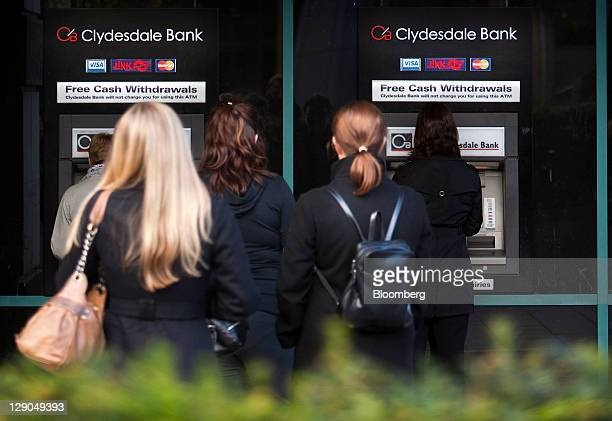 Customers queue to use automated teller machines outside a Clydesdale Bank branch in Edinburgh Scotland on Tuesday Oct 11 2011 Sun Capital backed by...