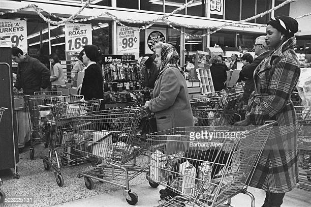 Customers queue up at Star Market with their shopping for New Years Eve celebrations Cambridge Massachusetts USA 28th December 1977
