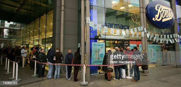 Customers queue up early at Boots the Chemist May 4 2007 in London Boots opened four of it's larger stores at 7am to allow customers to purchase the...