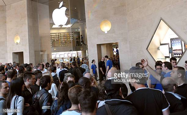 Customers queue up in front of a mobile phone store at the Carrousel du Louvre shopping mall in Paris on June 24 to buy the iPhone 4 The new US Apple...