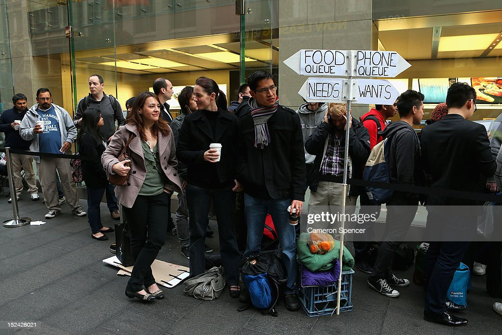 Customers queue up to purchase the iPhone 5 smartphone at the Apple flagship store on George street on September 21, 2012 in Sydney, Australia. Australian Apple stores are the first in the world to receive and sell the new iPhone 5 handsets.
