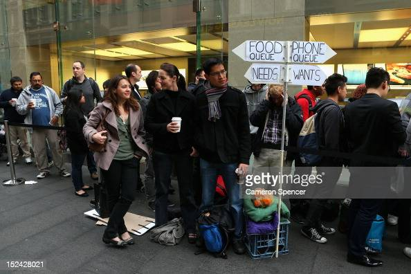 Customers queue up to purchase the iPhone 5 smartphone at the Apple flagship store on George street on September 21 2012 in Sydney Australia...