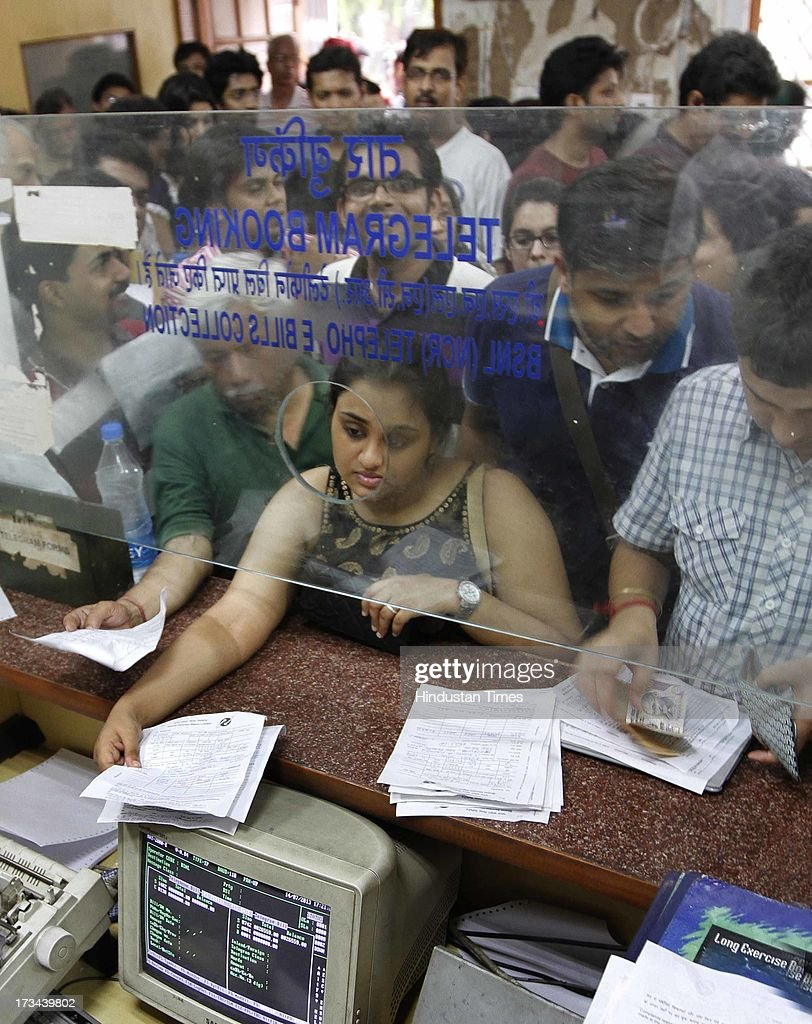 Customers queue up to send telegram to their friends and relatives on the last day of telegram service at Central Telegraph Office Eastern Court on July 14, 2013 in New Delhi, India. The work to lay telegraph lines started in 1850 on an experimental basis between Koklata and Diamond Harbour, it was opened for use by the British East India Company the following year. In 1854, the service was made available to the public. 163-year-old telegram service is being shut down by the Government from 15th of July, across the country.