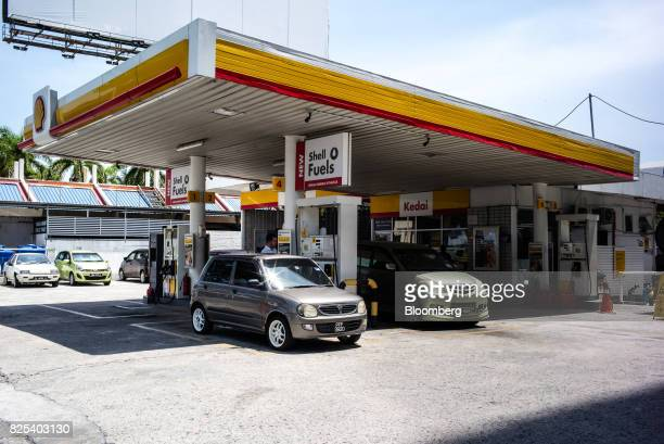 Customers refuel their cars at a Royal Dutch Shell Plc gas station in Kota Kinabalu in Sabah Malaysia on Sunday July 30 2017 Sabah and neighboring...
