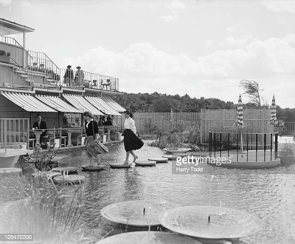 Customers relaxing in a corner of the water garden on the roof of Harvey's department store in Guildford Surrey 3rd September 1957