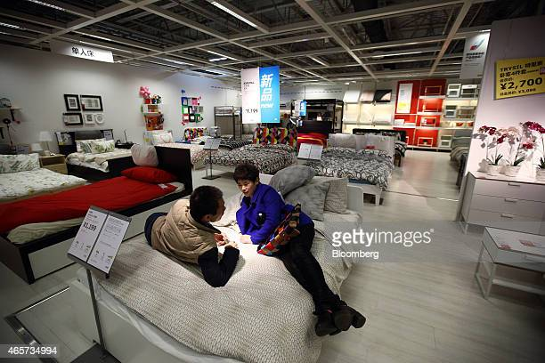 Customers rest on a bed inside the Ikea Beijing Xihongmen Store operated by Ikea AB in Beijing China on Monday March 9 2015 China's consumer prices...