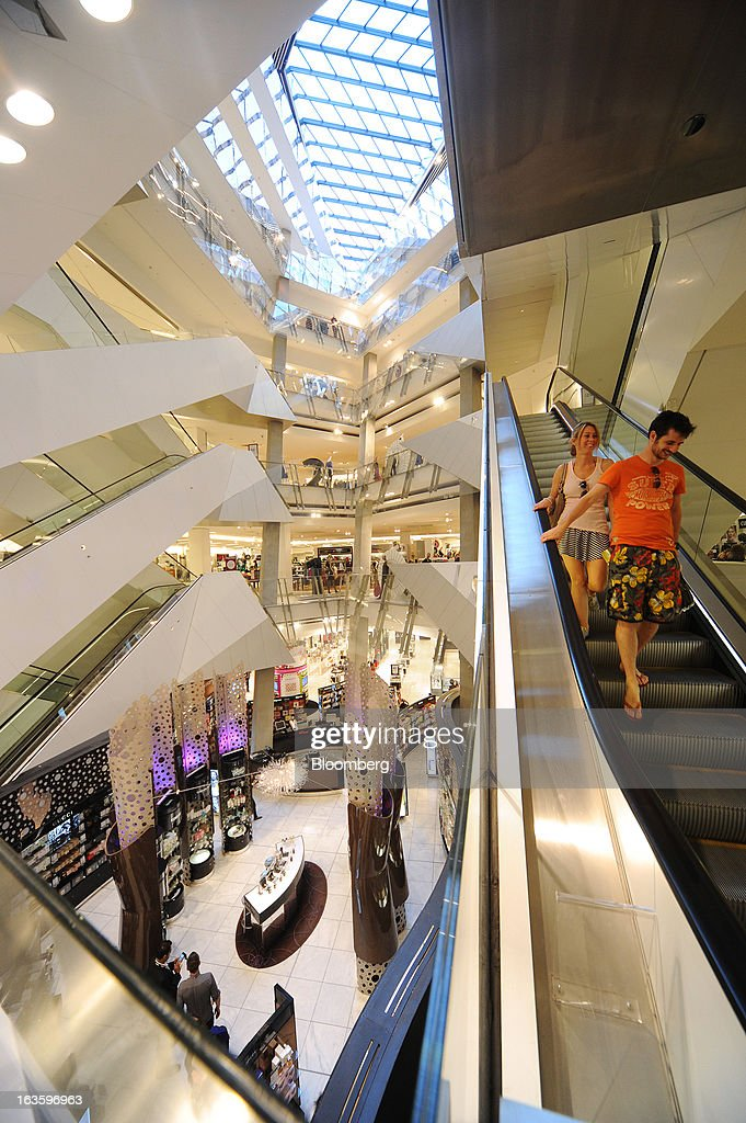 Customers ride on an elevator inside Myer Holdings Ltd.'s Melbourne City store in Melbourne, Australia, on Wednesday, March 13, 2013. Myer is scheduled to release company results on March 14. Photographer: Carla Gottgens/Bloomberg via Getty Images