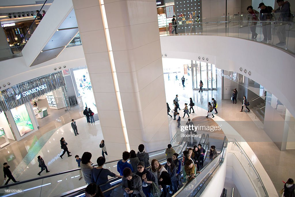 Customers ride on escalators at Hysan Development Co.'s Hysan Place mall in the Causeway Bay district of Hong Kong, China, on Monday, March 4, 2013. Hysan is scheduled to release earnings on March 6. Photographer: Lam Yik Fei/Bloomberg via Getty Images