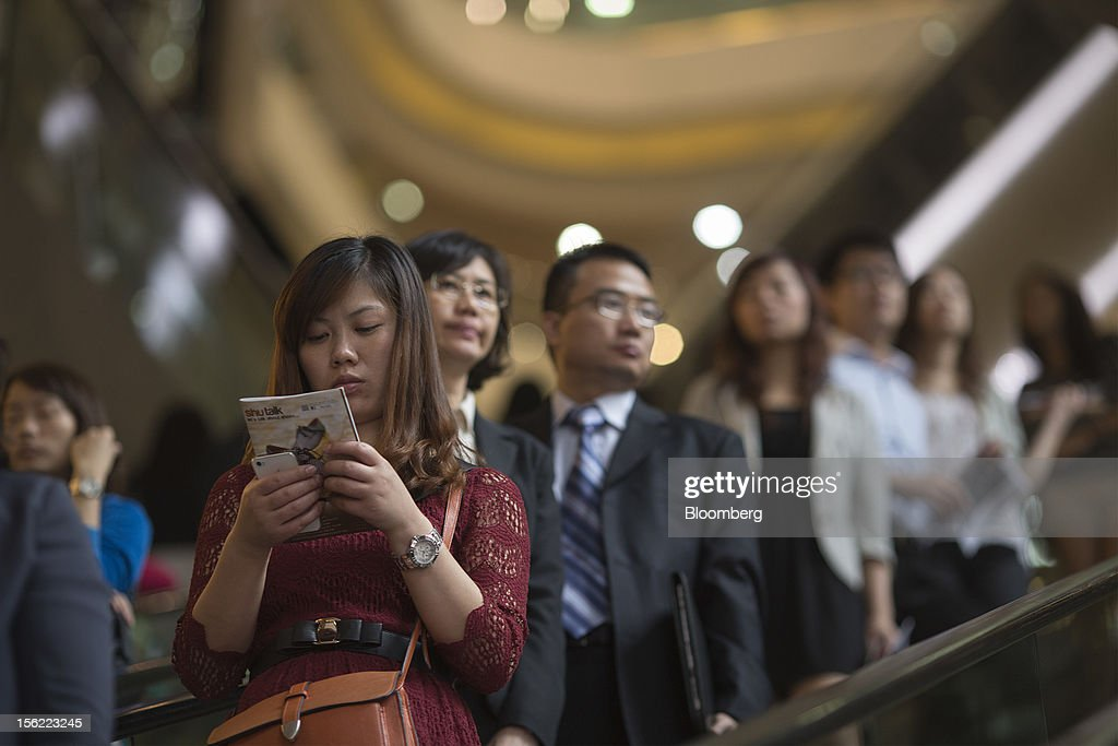 Customers ride on escalators at Times Square shopping mall, operated by Wharf (Holdings) Ltd., in the Causeway Bay district of Hong Kong, China, on Friday, Nov. 9, 2012. Wharf (Holdings) Ltd. is controlled by the family of billionaire Chairman Peter Woo. Photographer: Jerome Favre/Bloomberg via Getty Images