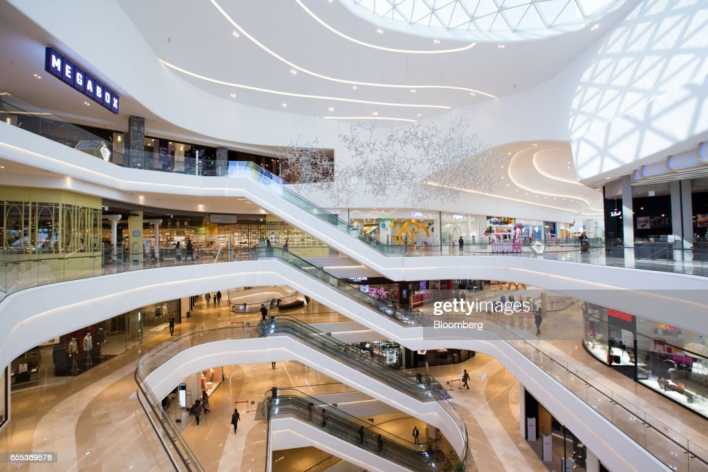 Customers ride walk inside the Starfield Hanam shopping complex, operated by Shinsegae Co., in Hanam, Gyeonggi, South Korea, on Wednesday, March 15, 2017. South Korea is scheduled to release consumer confidence figures on March 24. Photographer: SeongJoon Cho/Bloomberg via Getty Images