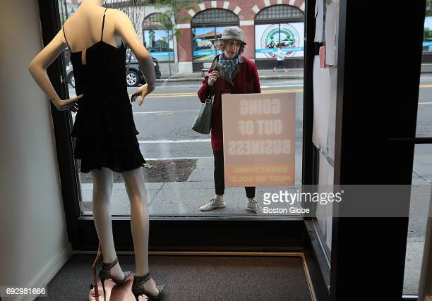 Customers see the business closing signs outside of the Second Time Around consignment shop in Brookline MA on Jun 5 2017 The consignment shops...