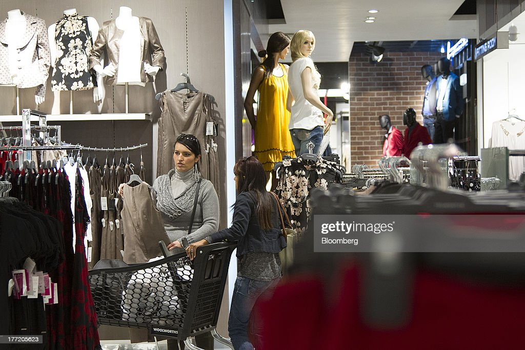 Customers select fashion clothing inside a Truworths International Ltd. store, South Africa's largest listed clothing retailer, in the Sandton district of Johannesburg, South Africa, on Thursday, Aug. 22, 2013. Massmart Holdings Ltd., the South African food and goods wholesaler owned by Wal-Mart Stores Inc., said revenue growth continued to slow in August after a downturn in consumer spending hurt first-half earnings. Photographer: Nadine Hutton/Bloomberg via Getty Images