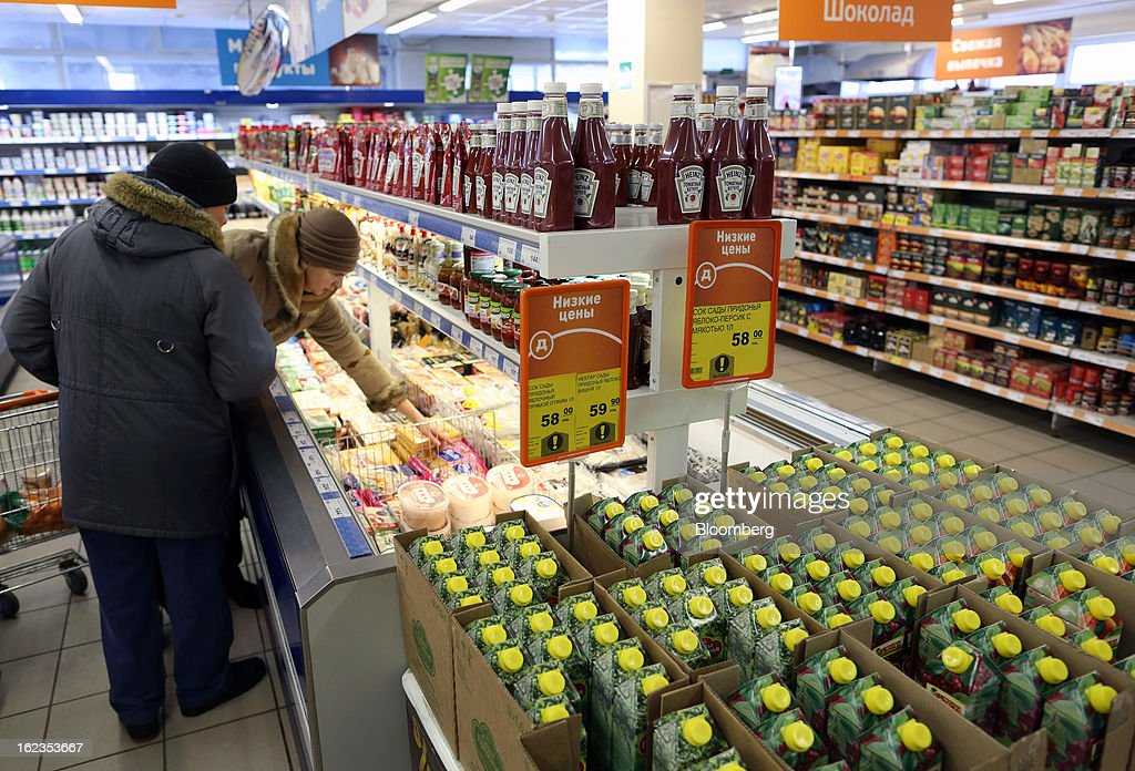 Customers select goods from a freezer cabinet inside a supermarket operated by OAO Dixy Group in Moscow, Russia, on Friday, Feb. 22, 2013. Russia's largest retailer by market value, OAO Magnit, is spending as much as $1.8 billion this year to compete against X5 Retail Group NV and OAO Dixy Group. Photographer: Andrey Rudakov/Bloomberg via Getty Images