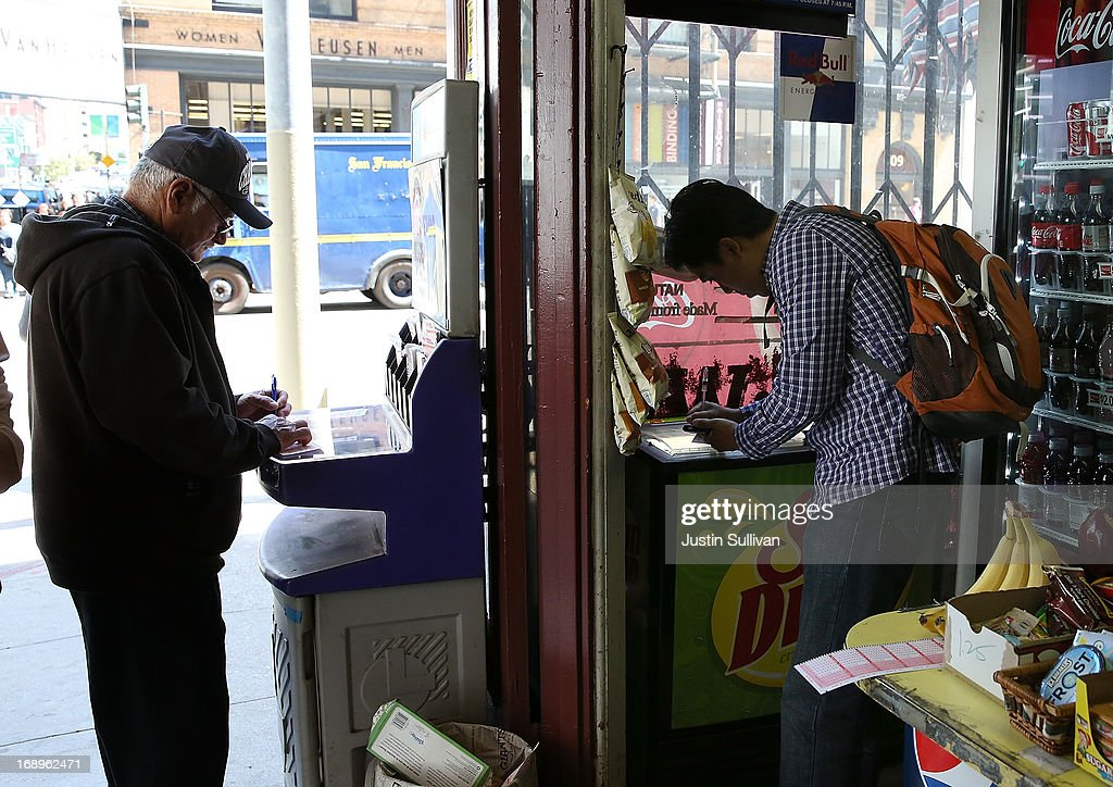 Customers select numbers before purchasing Powerball tickets on May 17, 2013 in San Francisco, California. People are lining up to purchase $2 Powerball tickets as the multi-state jackpot hits $600 million.