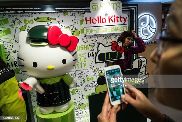Customers shop and take photographs inside the Hello Kitty theme supermarket on February 17 2017 in Hong Kong Hong Kong The world's first Hello Kitty...
