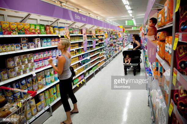 Customers shop at a Coles Group Ltd supermarket in Perth Australia on Wednesday Feb 17 2010 Wesfarmers Ltd who owns retail chains operates mines and...