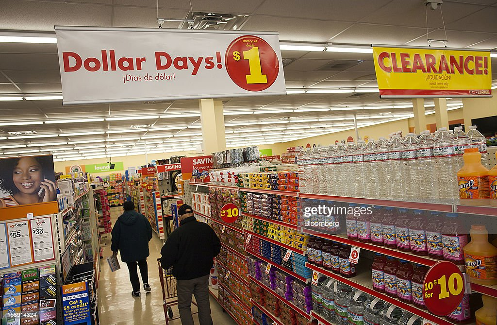 Customers shop at a Family Dollar Stores Inc. store in Belleville, New Jersey, U.S., on Thursday, Jan. 3, 2013. Family Dollar Stores Inc., the second-largest U.S. dollar store chain, tumbled the most in more than 12 years after cutting its fiscal 2013 earnings forecast, saying consumers are reluctant to spend on more-profitable discretionary items. Photographer: Michael Nagle/Bloomberg via Getty Images