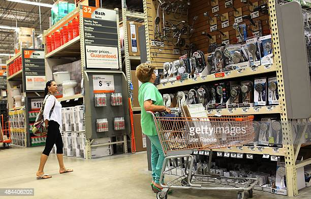 Customers shop at a Home Depot on August 18 2015 in Miami Florida Today Home Depot shares rose as the company reported secondquarter earnings that...